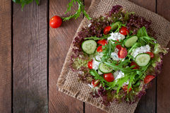 Dietary salad. Useful dietary salad with cottage cheese, herbs and vegetables Royalty Free Stock Image