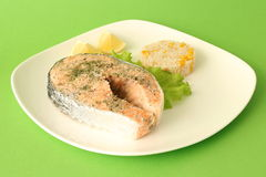 Dietary salmon fillet with rice and lemon Royalty Free Stock Photography
