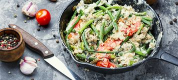 Dietary scrambled eggs from proteins. Protein scrambled eggs with asparagus beans. Fried eggs with vegetables royalty free stock image