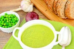 Dietary Soup Cream Puree of Green Peas. Studio Photo stock image
