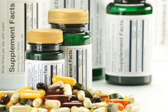 Dietary supplement capsules and containers Stock Images