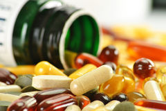 Dietary supplement capsules and containers Stock Photo
