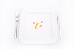 Dietary Supplementation. Pills or medication as a dietary supplementation Stock Photos