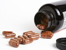Dietary supplements. Flowing from a container stock image