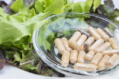 A dietary supplements Capsules on glass dish with Fresh vegetabl Royalty Free Stock Photography