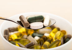 Dietary supplements in spool. Close-up dietary supplements in spool Royalty Free Stock Photos