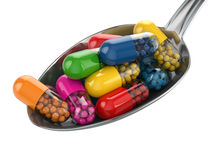 Dietary supplements. Variety pills. Vitamin capsules on the spoo Stock Image