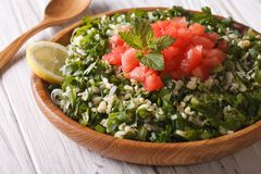 Dietary Tabbouleh salad closeup in a wooden bowl. Horizontal Royalty Free Stock Photography