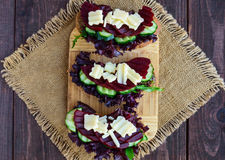 Dietary vitamin sandwiches with lettuce leaves, cucumber, beet and cheese on rye bread. Royalty Free Stock Image