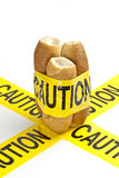 Dietary warning or gluten/wheat allergy warning. (Fresh French bread wrapped in yellow caution tape Stock Image