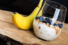 Dietetic breakfast - fruits, yoghurt and muesli. Dietetic breakfast - fruits yoghurt and muesli stock photography