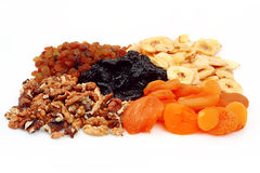 Dietetic dried fruits. Are distributed on white background Royalty Free Stock Photos