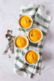 Dietetic food. Four servings of carrot flan. Top view on light background royalty free stock photos
