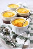 Dietetic food. Four servings of carrot flan on light background. Focus selective royalty free stock photos