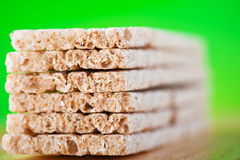 Dietetic loaves on green background Stock Image