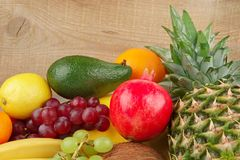 Dietetic set of paleo diet of fruits on wooden plank Royalty Free Stock Images
