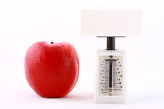 Dietic concept: red apple and white balance Stock Photo