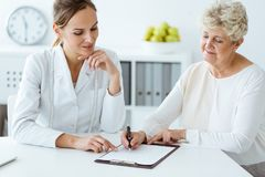Dietician and diabetic discussing diet stock photos