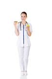 Dietician holding sweet doughnut and fresh healthy green apple. Stock Photos