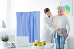 Dietician measuring woman`s body circuit Royalty Free Stock Photos