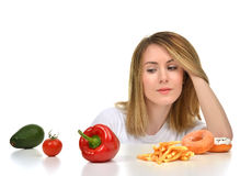 Dietician woman looking at vegetables avocado tomato pepper and Stock Images