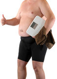 Dieting. Fat man with bathroom scale as symbol for making a diet Stock Photos