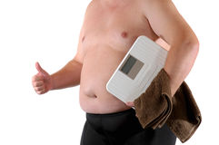 Dieting. Fat man with bathroom scale as symbol for making a diet Royalty Free Stock Image