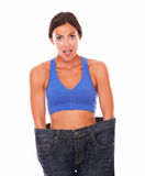 Dieting beautiful woman measuring body waist Royalty Free Stock Image
