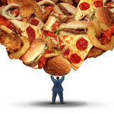 Dieting Challenge. Health concept with an obese person holding up a group of unhealthy fatty fast food as a health risk symbol of bad nutrition and risk of royalty free illustration