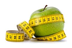 Dieting concept with apple Royalty Free Stock Photos