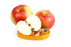 Dieting concept with apple and measuring tape Stock Image