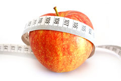 Dieting concept with apple and measuring tape Royalty Free Stock Photos