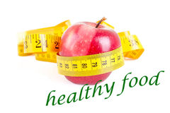 Dieting concept apple with measuring tape on white Royalty Free Stock Photo