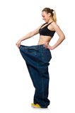 Dieting concept with big jeans on white Royalty Free Stock Photo