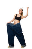 Dieting concept with big jeans on white Stock Photography