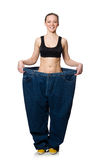 Dieting concept with big jeans on white Stock Images