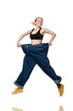 Dieting concept with big jeans on white Stock Photo