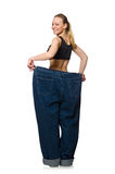 Dieting concept with big jeans on white Royalty Free Stock Images