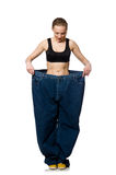 Dieting concept with big jeans on white Royalty Free Stock Image