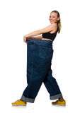 Dieting concept with big jeans on white Stock Photos
