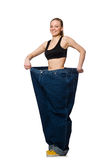 The dieting concept with big jeans on white Royalty Free Stock Photography