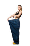 The dieting concept with big jeans on white Royalty Free Stock Images
