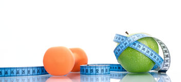 Dieting concept green apple with measuring tape Royalty Free Stock Photography