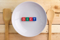 Dieting concept image text on the white plate.jpg Stock Photography