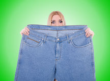 Dieting concept with oversize jeans Royalty Free Stock Image