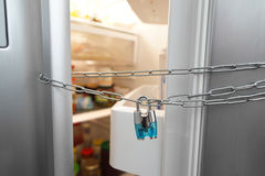 Dieting concept. Refrigerator, chain and lock Royalty Free Stock Photos