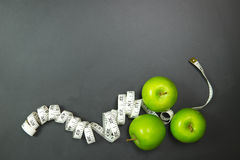 Dieting concept using green apples Royalty Free Stock Photos