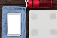 Dieting and control calories for good health concept. smart weight scales tablet device and Drinking bottle on board. fitness. Dieting and control calories for royalty free stock image