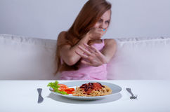Dieting girl can't eat dinner Royalty Free Stock Images
