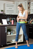 Dieting girl on her kitchen Royalty Free Stock Photography